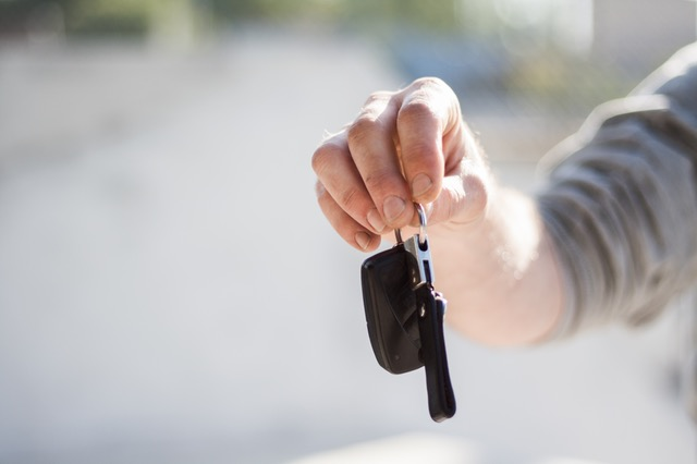 Man extending his arms to give car keys
